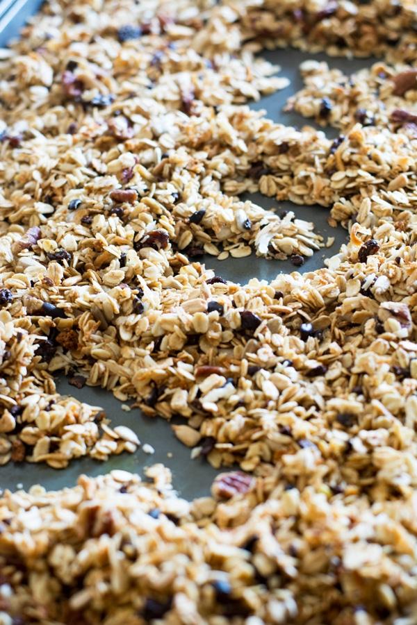 Homemade granola on a baking sheet.