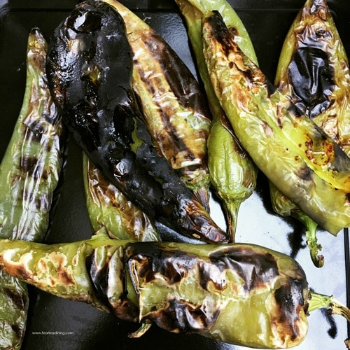 Fire roasted hatch chiles on a baking dish.