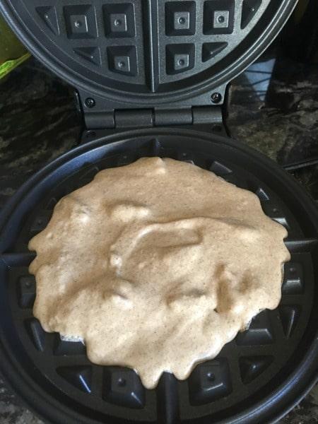 Banana flour waffle batter in a waffle iron