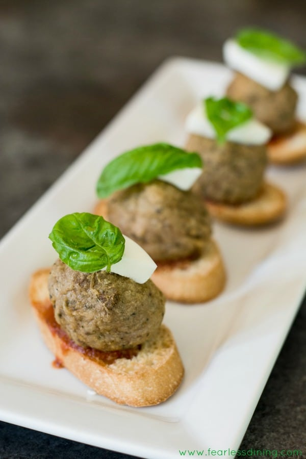 Meatball crostini on a serving tray