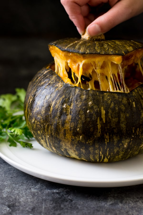 Pulling the top off a stuffed roasted kabocha squash