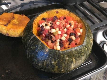 A kabocha squash stuffed with a Mexican flavored corn and tomato dish.