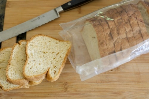 Slices of gluten free bread on a cutting board.