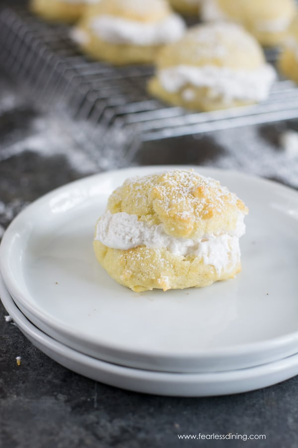 A gluten free cream filled puff on a white plate