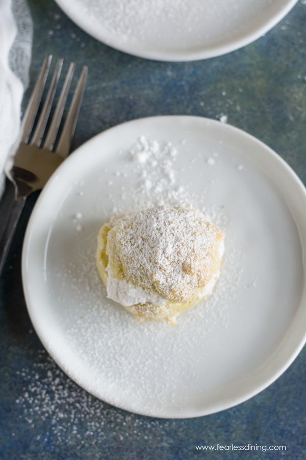 close up top view of a powdered sugar dusted cream puff