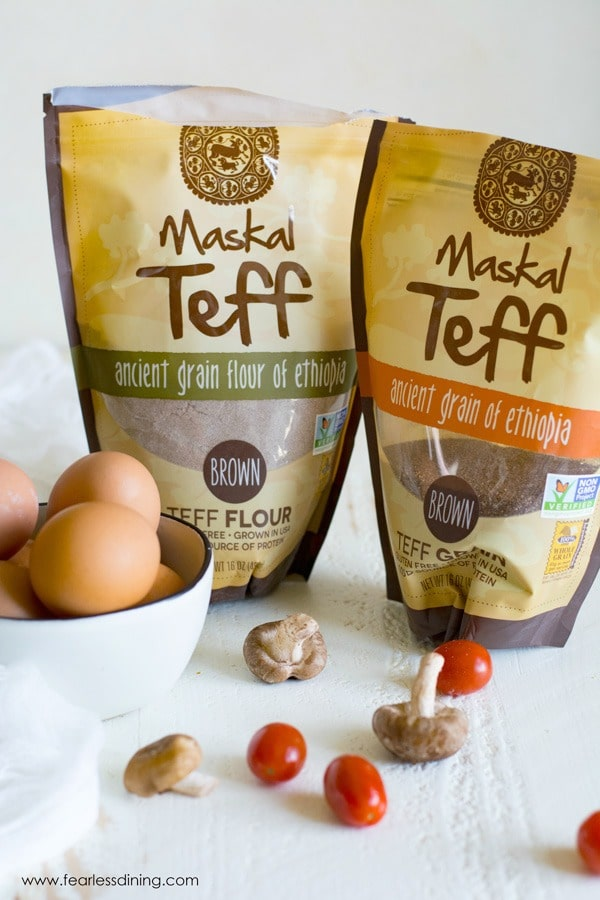 two bags of teff next to a bowl of eggs and other ingredients