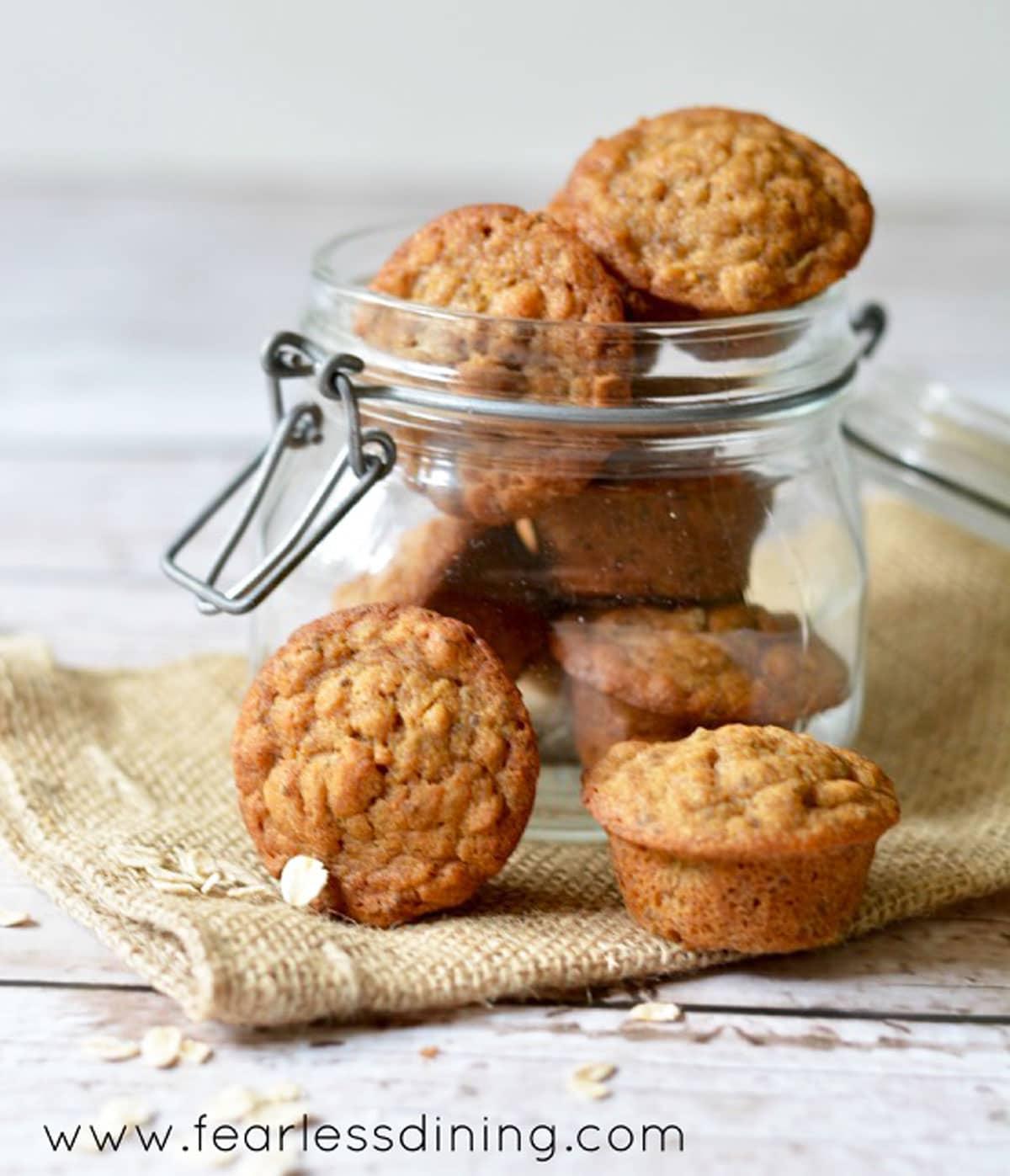 a jar of mini banana oat muffins
