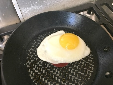 sunny side up egg frying in a pan