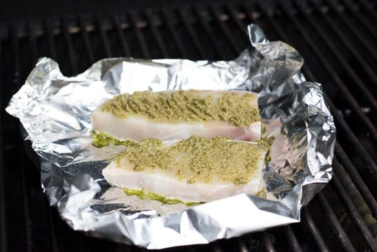 halibut steaks on foil on the grill