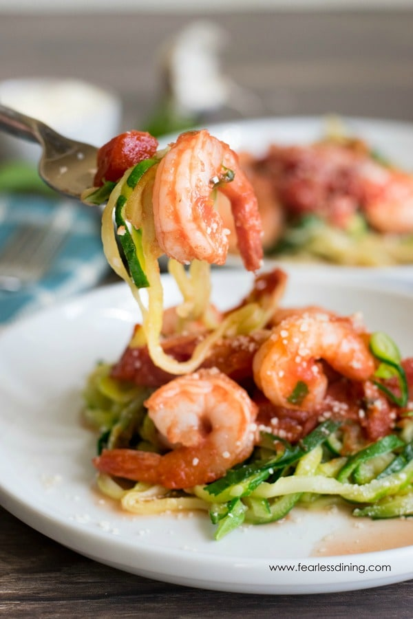 a shrimp, and zucchini noodles on a fork.