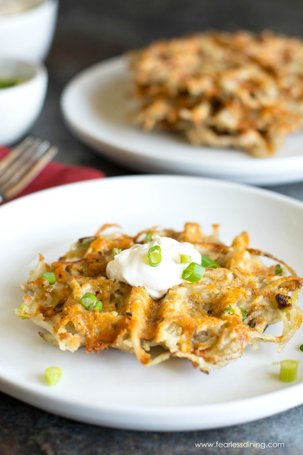 Crispy potato waffles on plates