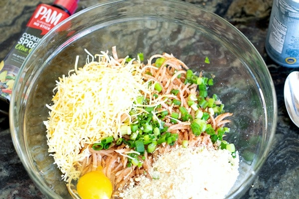 Potato hash brown waffle ingredients in a bowl.