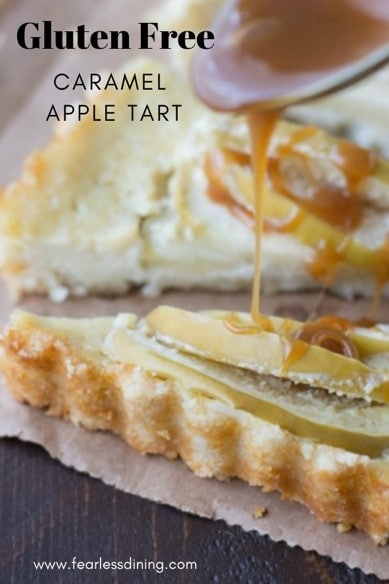 a spoon drizzling caramel over an apple tart slice