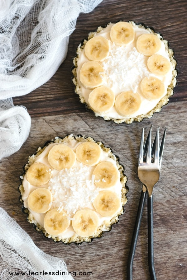 top view of two banana cream Greek yogurt tarts.
