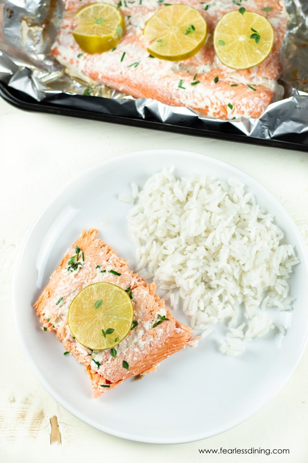 top view of a plate of grilled salmon and rice