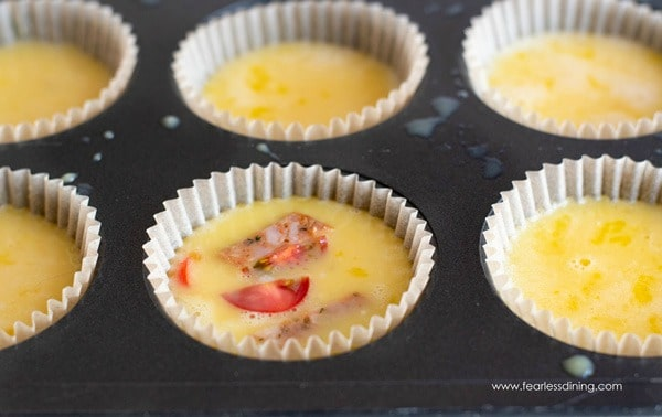 egg muffins in a muffin tin ready to bake