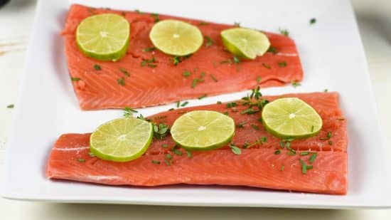 Top view of the salmon with herbs