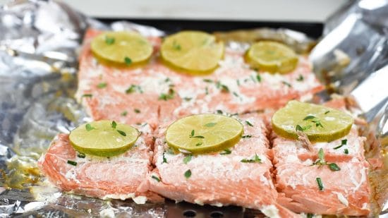 slicing the cooked salmon.