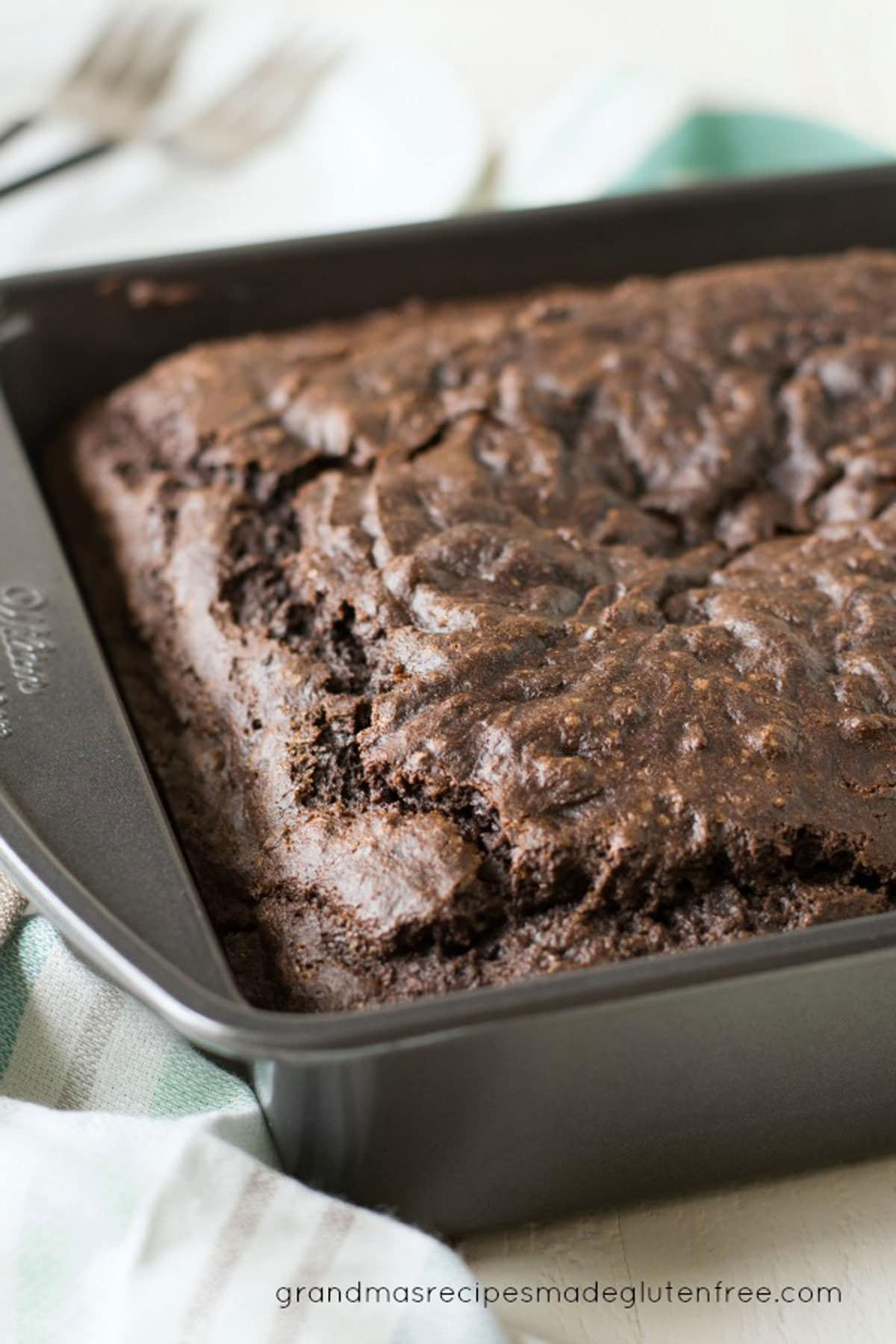 a delicious gluten free chocolate cake in an 8x8 pan