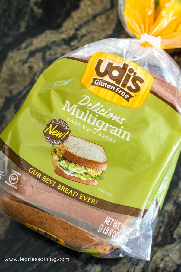 A loaf of Udi's gluten free bread on a counter.