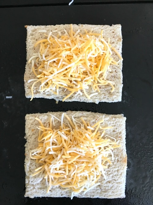 shredded cheese on slices of gluten free bread