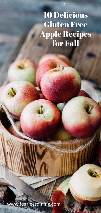 A wooden bowl full of apples