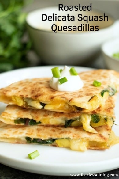 Slices of roasted delicata squash quesadillas on a plate