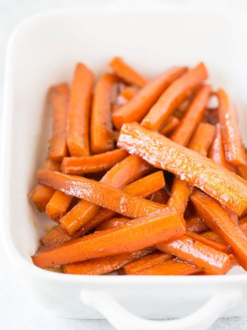 a baking dish of cooked carrots