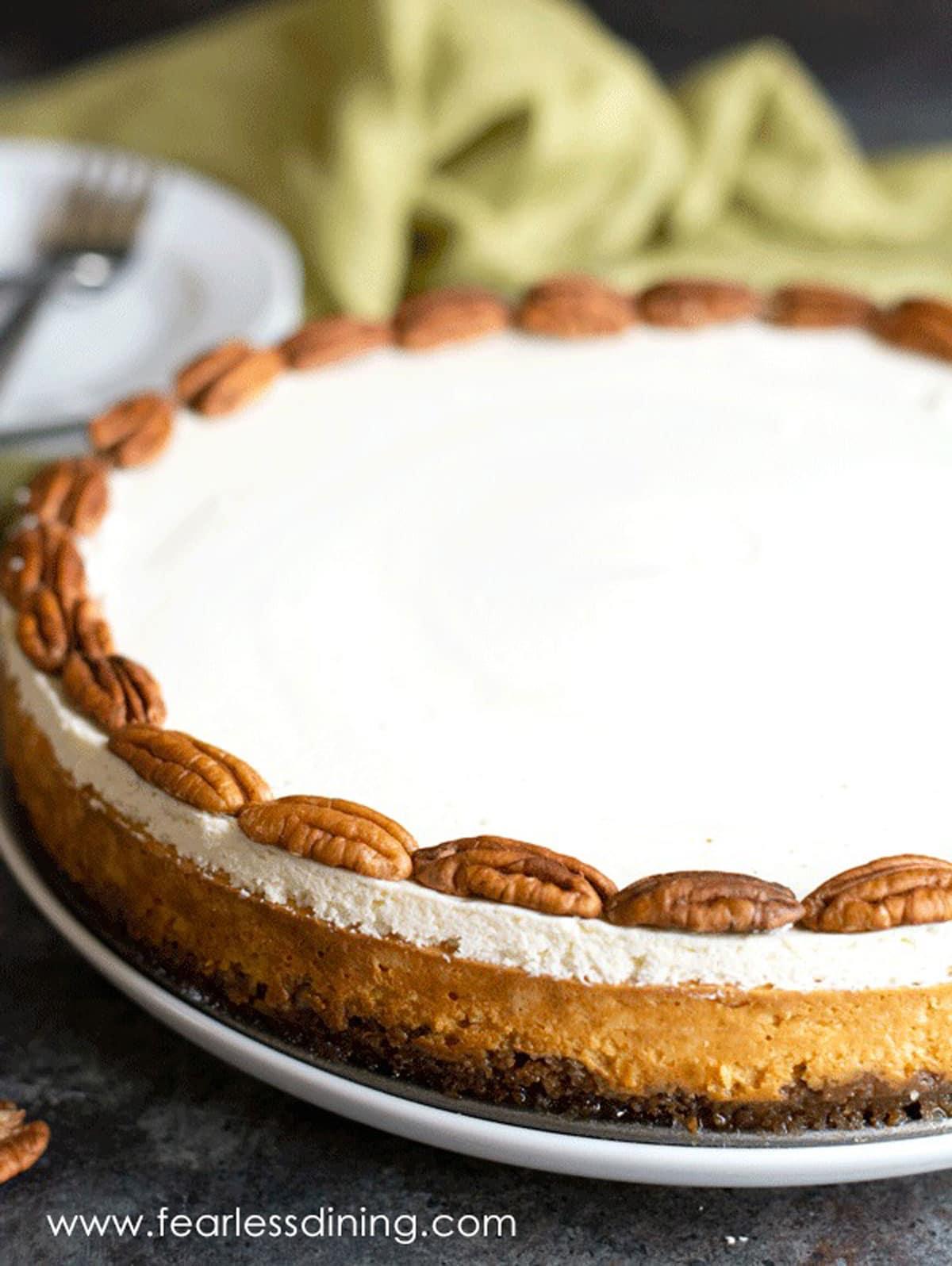 a gluten free pumpkin cheesecake on a table