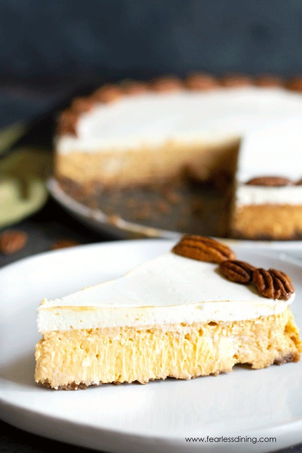 a slice of gluten free pumpkin cheesecake on a plate