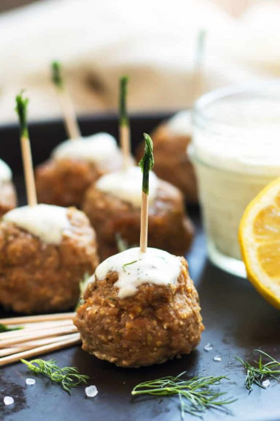 meatballs on a serving platter with toothpicks in each
