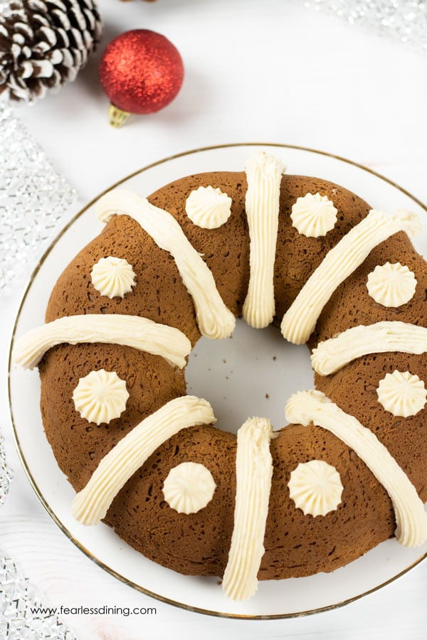 A gluten free gingerbread bundt cake with cream cheese frosting decoration.