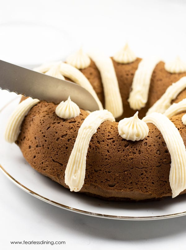 A knife cutting into a gluten free gingerbread bundt cake