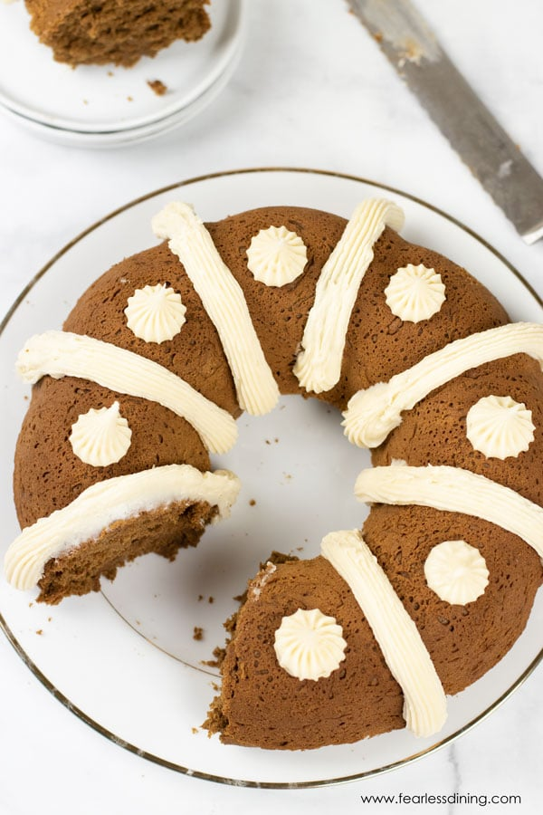 top view of a gluten free gingerbread bundt cake with a slice cut out