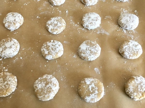smooshed cookie dough balls on a baking sheet