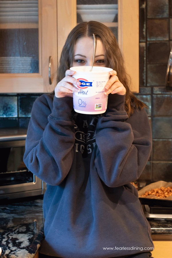 My daughter holding up the FAGE yogurt container