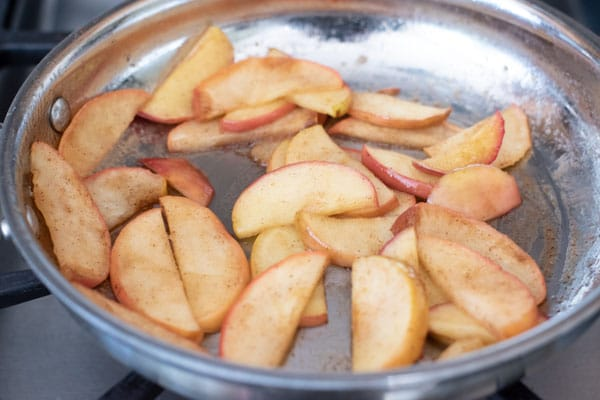 cooking cinnamon apple slices in a pan