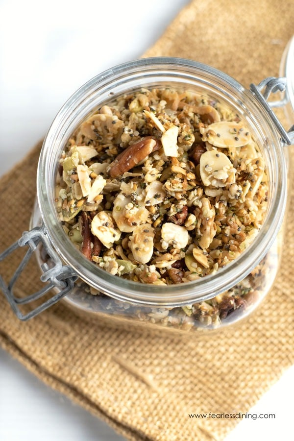 close up view of grain-free paleo granola in a glass jar