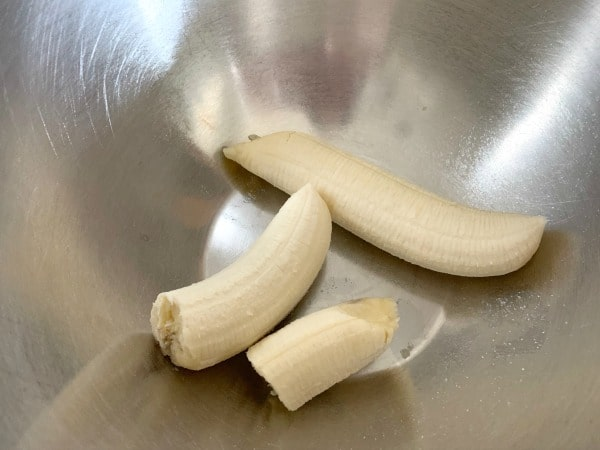 peeled bananas in a bowl ready to smash up