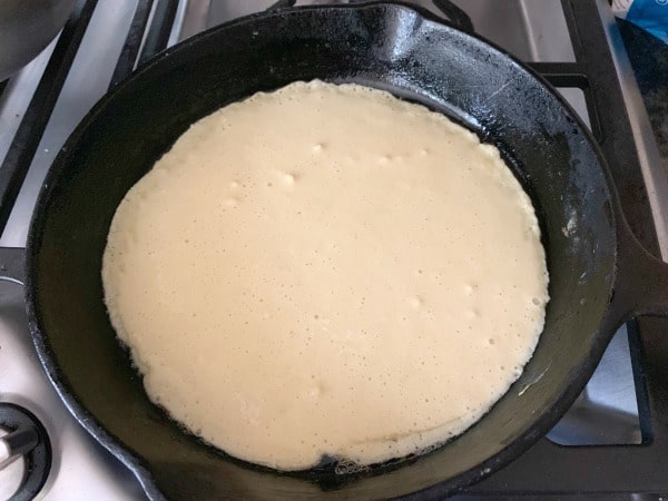blintz batter cooking in a pan