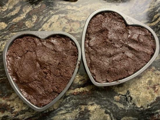 gluten free brownie batter in heart shaped cake pans
