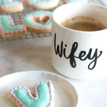 a V shaped sugar cookie on a plate
