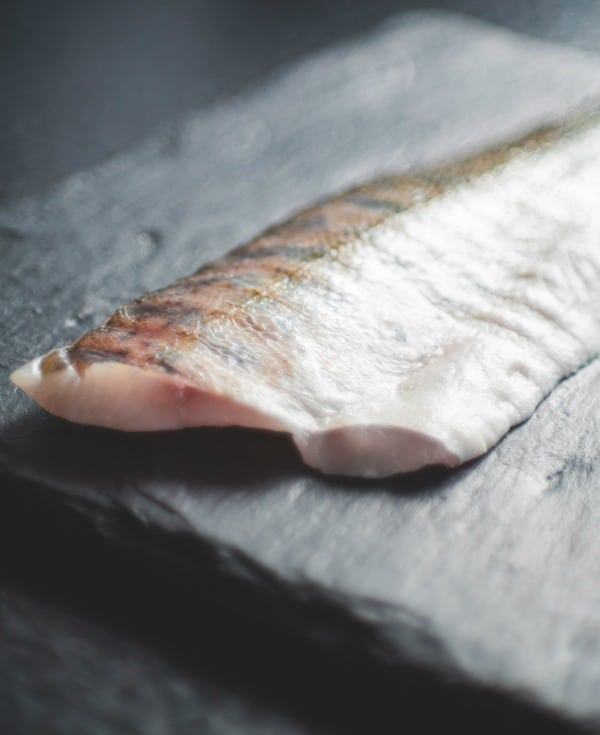 a fish filet on a slate tile