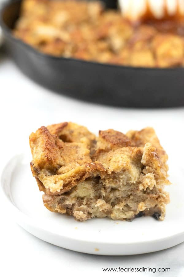 a slice of gluten free banana bread pudding on a plate