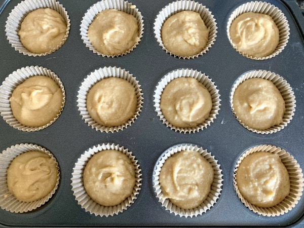 cupcake batter in a lined muffin tin ready to bake