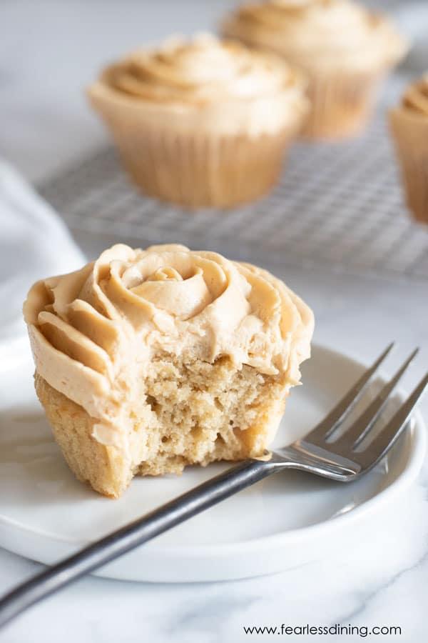 a fork next to a gluten free caramel cupcake.