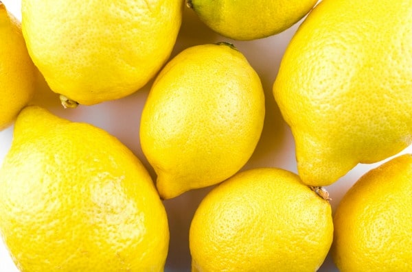close up of lemons on a counter all pressed together