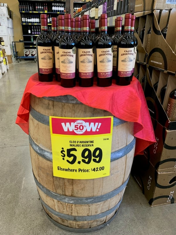 a display of wines on a barrel