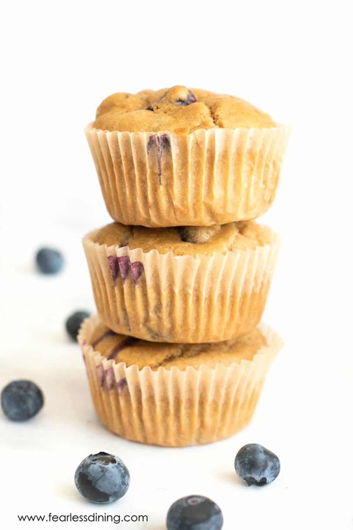a stack of blueberry muffins