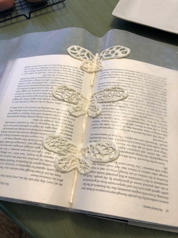 three white chocolate dragonflies hardening